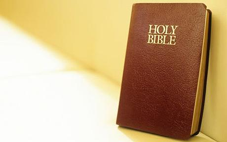 Holy Bible on beige sofa,close-up